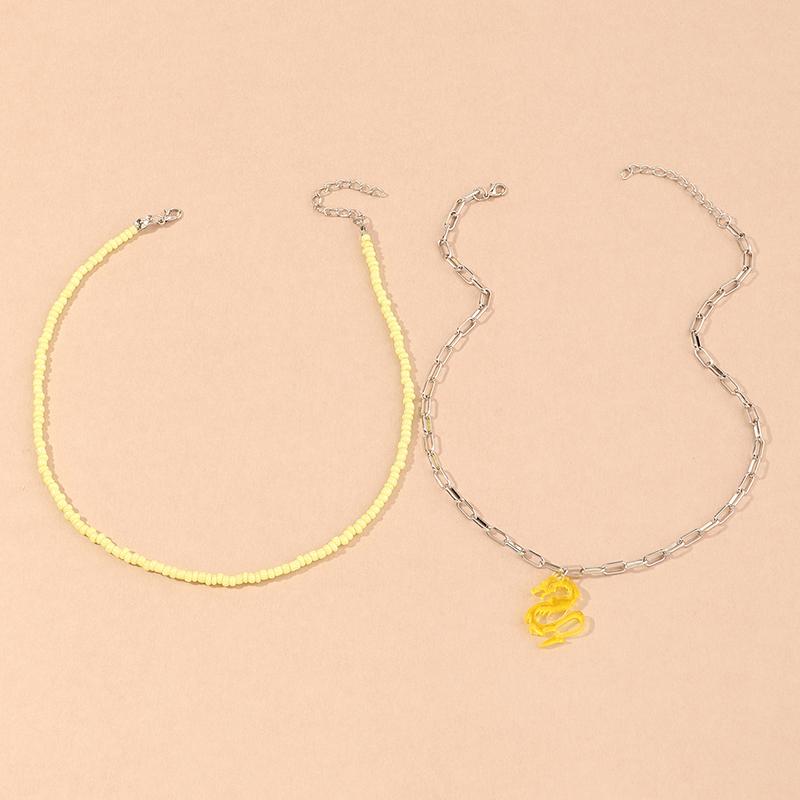 collier de perles rondes pendentif dragon dor NHNU327662